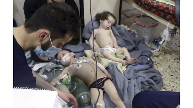 Dozens killed in 'poison gas attack' near Syrian capital