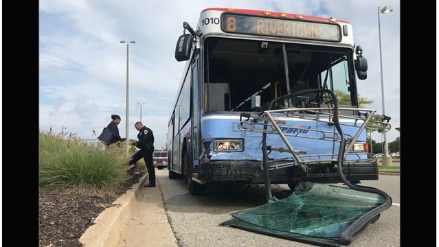 Police: Driver ran red light, collided with bus