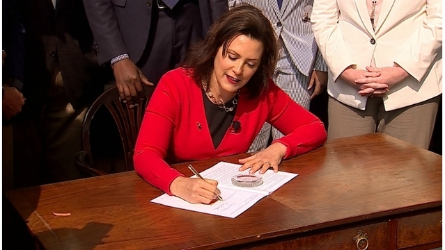 Whitmer signing car insurance law 05302019_1559228321974.jpg.jpg